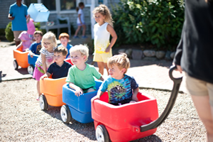 Toddlers Riding in Toy Carts at the Winnetu
