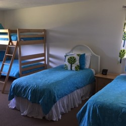 3rd bedroom in SB15 with 2 twin beds and 2 sets of bunk beds