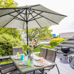 View of Deck Furniture & Umbrella on Mattakesett Townhouse's C5 Outdoor Deck