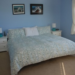 View of King Bed in Master Bedroom of Mattakesett Townhouse G8