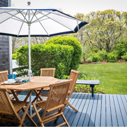 View of Furniture & Lawn on Outdoor Deck of Mattakesett Townhouse B7